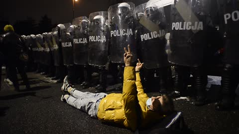 protester lays on the floor and gesticulates towards riot police during a protest against the near-total ban on abortion on january 29, 2021 in... - poland stock videos & royalty-free footage