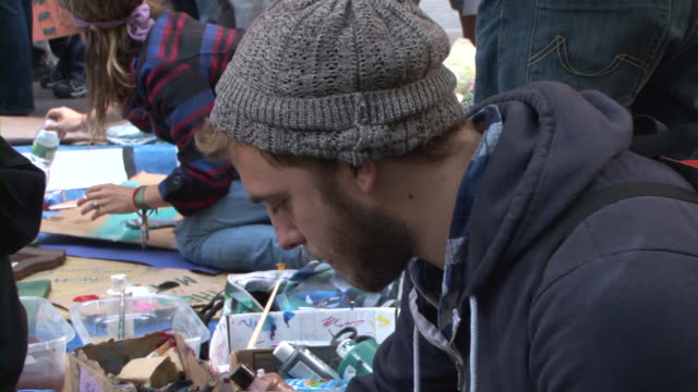 protester making sign during occupy wall street movement audio / new york city, new york, united states - occupy protests stock videos & royalty-free footage