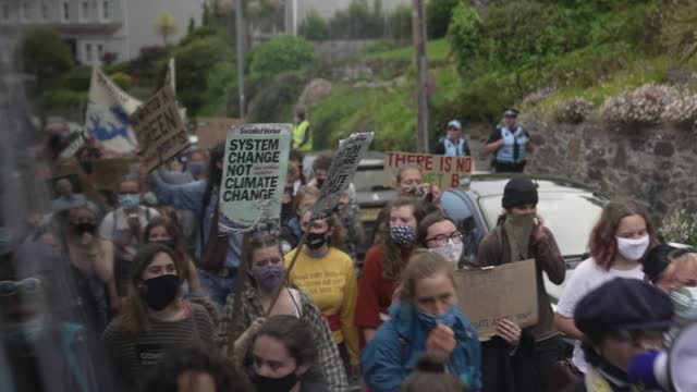 protester march through the town during a climate change event organised by cornwall climate youth alliance in partnership with fridays for future... - partnership stock videos & royalty-free footage