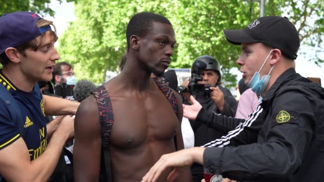 protester meet and talk on south bank on june 13, 2020 in london, united kingdom. following a social media post by the far-right activist known as... - demonstrant stock-videos und b-roll-filmmaterial