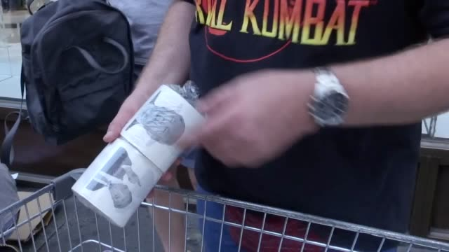 a protester sells donald trump toilet rolls from a trolley in oxford circus at the 'stop trump' protest against the president's state visit to the uk - bathroom stock videos & royalty-free footage