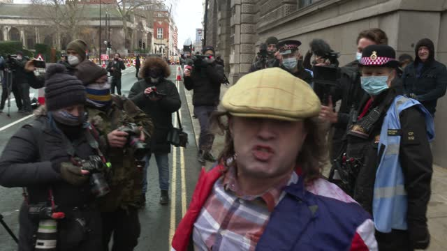 protester shouts as her protests outside the old bailey on january 04, 2021 in london, england. district judge vanessa baraitser has denied the... - crime or recreational drug or prison or legal trial stock videos & royalty-free footage