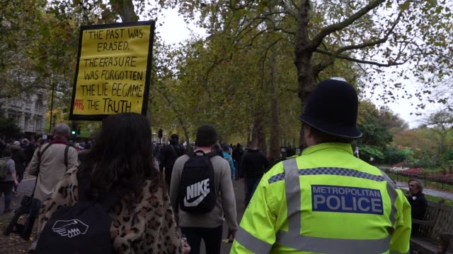 a protester talks to a uk police officer as protesters show a lack of social distancing during a unite for freedom march on october 24 2020 in london... - form of communication stock videos & royalty-free footage