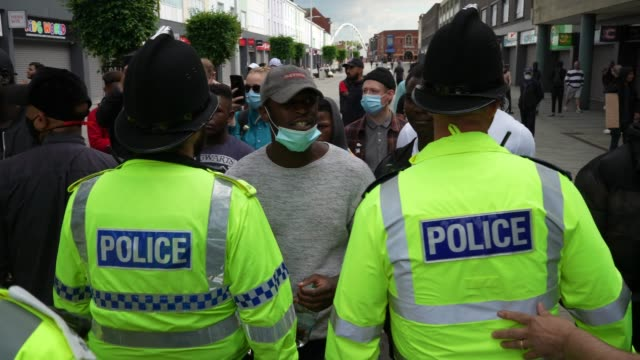 protester wearing a protective mask argues with police during an anti-racism demonstration on june 13, 2020 in bolton, england. a number of... - protestor stock videos & royalty-free footage