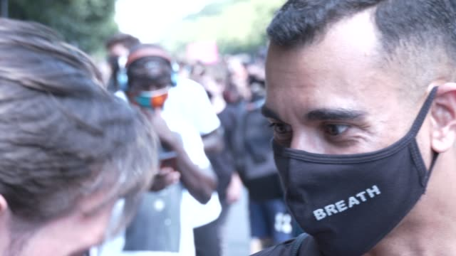 a protester wears face mask reading 'i can't breathe' during a rally for black lives matter gather at the victory column in tiergarten park on june... - i can't breathe stock videos & royalty-free footage