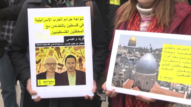 Protesters accompanied by Morocco Branch of Amnesty International gather in front of parliament building to denounce the controversial decision by...
