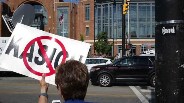 protesters against ohio governor john kasich hold signs outside of the ohio state university student union in columbus ohio us on tuesday july 21... - ohio state university stock videos & royalty-free footage