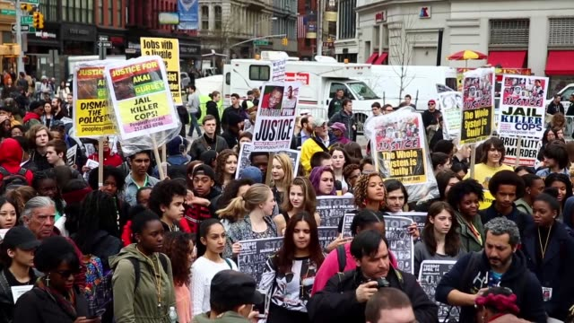 protesters against police violence march in manhattan on april 14 2015 in new york city a coalition of anti police violence and anti racist... - sprechgesang stock-videos und b-roll-filmmaterial