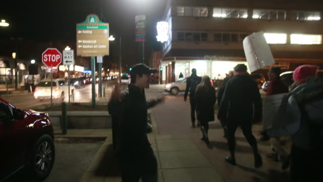 protesters against trump's muslim travel ban held a rally and then marched on kirkwood avenue to the monroe county courthouse some trump supporters... - ausschluss stock-videos und b-roll-filmmaterial