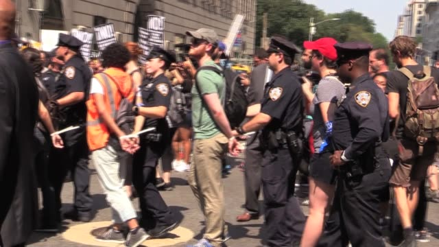 Protesters against Trump's repeal of DACA sit in on 5th avenue and arrests in front of Trump Tower