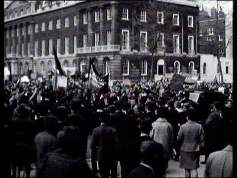 protesters against vietnam war march down street; 1960's - vietnam war stock videos & royalty-free footage