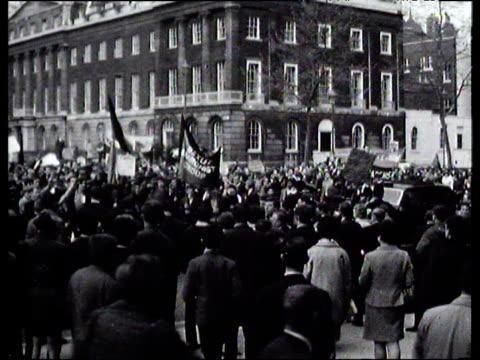 protesters against vietnam war march down street; 1960's - vietnamkriget bildbanksvideor och videomaterial från bakom kulisserna