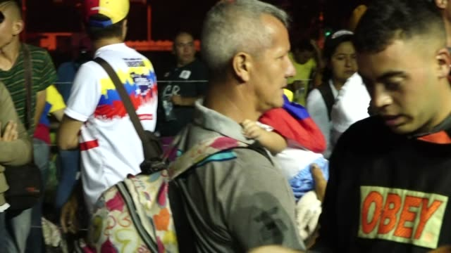 Protesters along the Colombian border after aid shipments been stopped by President Nicolas Maduro's government on 23 February 2019 in Cocuta Colombia