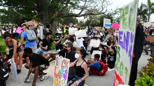protesters and clergyman demonstrates against police brutality and racism on june 07, 2020 in hollywood, florida. the recent death of george floyd in... - hollywood florida stock videos & royalty-free footage