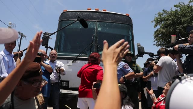 protesters and immigration activists try to block a bus carrying migrant children out of a u.s. customs and border protection detention center on... - mcallen texas stock videos & royalty-free footage