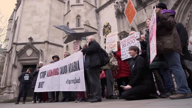 protesters and members of the campaign against the arms trade demonstrate outside the royal courts of justice against uk arms sales to saudi arabia... - sale stock videos & royalty-free footage