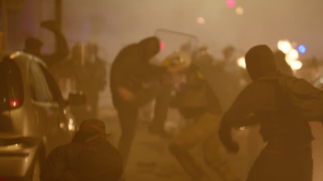 protesters and riot police fighting, greek town square - night - protestor stock videos & royalty-free footage