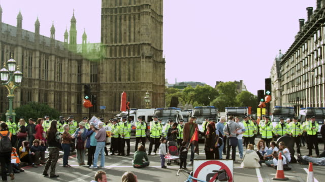 LONDON - OCTOBER 9: Protesters and unidentified policemen near Big Ben on October 9, 2011 in London.