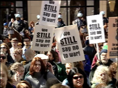 protesters at 2004 antiwar rally with signs on march 20 2004 in chicago illinois - 2001年~ アフガニスタン紛争点の映像素材/bロール