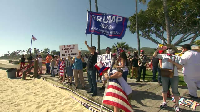 protesters at laguna beach during the coronavirus pandemic in california - laguna beach california stock videos & royalty-free footage