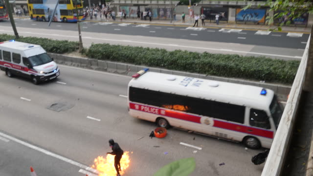 protesters attack police at they flee harcourt road in wan chai and threw molotov cocktails and bricks at police who fired tear gas and rubber... - wan chai stock videos & royalty-free footage