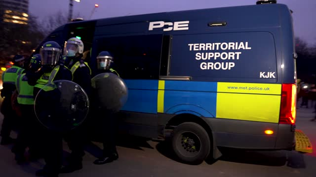 """protesters attack uk police vans as they flee on march 20, 2021 in london, england. """"world wide rally for freedom"""" protests, with apparent links to... - ideas stock videos & royalty-free footage"""