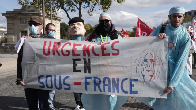 """protesters behind a banner reading """"suffering emergencies"""" during a day of mobilization and national strike in the health, medico-social and social... - rettungsdienst mitarbeiter stock-videos und b-roll-filmmaterial"""
