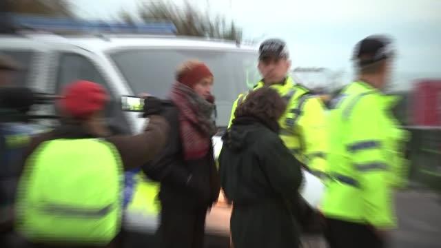 protesters blockade cuadrilla site; england: lancashire: little plumpton: ext various of anti-fracking demonstrators protesting at entrance to... - protesta anti fracking video stock e b–roll