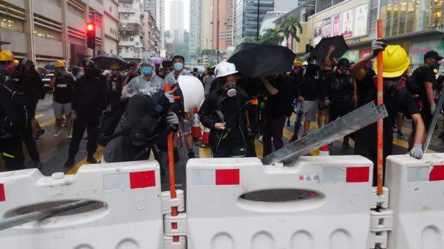 protesters blocked yeung uk rd in tsuen wan and setup barriers and battled with police police fired many rounds of tear gas and rubber bullets to... - barricade stock videos & royalty-free footage