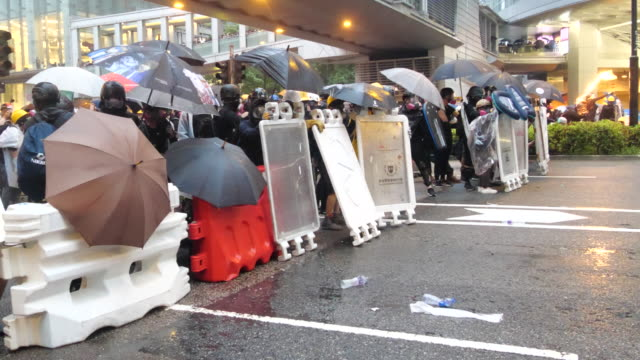 protesters blocked yeung uk rd in tsuen wan and setup barriers and battled with police police fired many rounds of tear gas and rubber bullets to... - molotov cocktail stock videos and b-roll footage