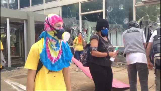 protesters broke windows of public buildings wednesday during a protest in brasilia as police fired tear gas and stun grenades in confrontations with... - confrontation stock videos and b-roll footage
