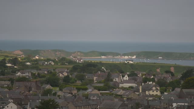 protesters call for cap on second homes in wales; wales: pembrokeshire: cwm-yr-eglwys: ext *drone footage* air view cove and few houses at... - pembroke stock videos & royalty-free footage