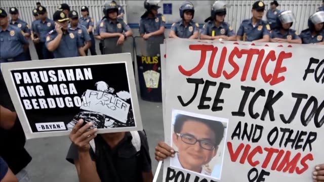 Protesters call for justice for the victims of the Philippine government's anti drugs war carrying mock dead bodies and placards showing the picture...