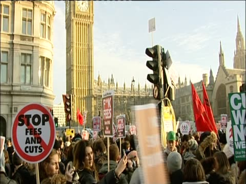Protesters carry banners on the day the House of Commons vote on proposed rises in university tuition fees
