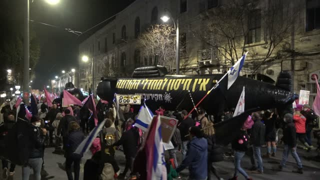 protesters carry large submarine mock-ups as they march through downtown jerusalem on their way to the prime minister's official residence during a... - eddie large stock videos & royalty-free footage
