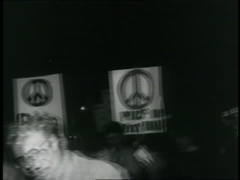 Protesters carry signs during an antiwar demonstration