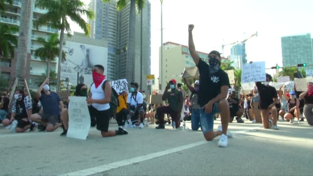 protesters chant i can't breath and say his name as they take to the streets of miami on sunday to demand justice for george floyd - i can't breathe stock videos & royalty-free footage