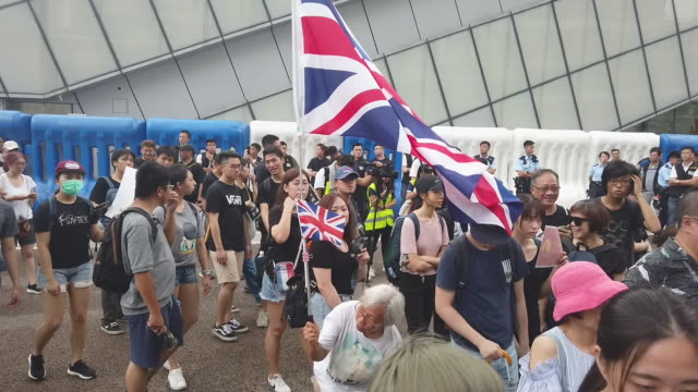 Protesters chant slogans after arriving at the West Kowloon railway station during a protest against the proposed extradition bill on July 7 2019 in...