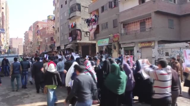 protesters chant slogans and hold posters of former president of egypt mohamed morsi during a demonstration against egyptian administration in giza... - president of egypt stock videos & royalty-free footage
