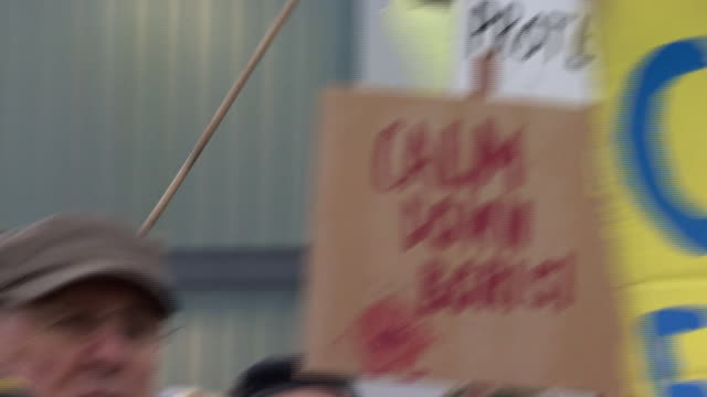 """protesters chanting """"tories out"""" outside the conservative party manifesto launch in telford - politics stock videos & royalty-free footage"""