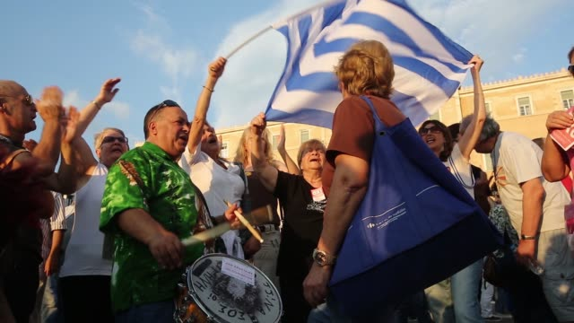 Protesters clap chant and bang drums during an antiausterity demonstration in support of the Greek government in Syntagma Square in Athens Greece on...