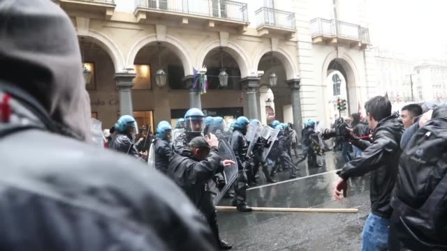 protesters clash with italian riot police officers during the celebration of celebrate may day in turino italy on 1st may 2017 - piedmont italy stock videos & royalty-free footage