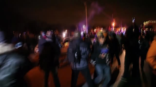 Protesters clash with police during protests broke out after grand jury's decision not to indict a police officer Darren Wilson in the shooting of...