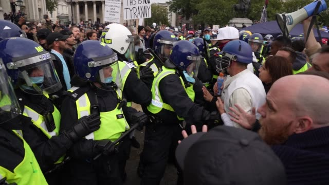 """protesters clash with police officers during a """"we do not consent"""" anti-lockdown rally at trafalgar square on september 26, 2020 in london, england.... - lockdown stock videos & royalty-free footage"""