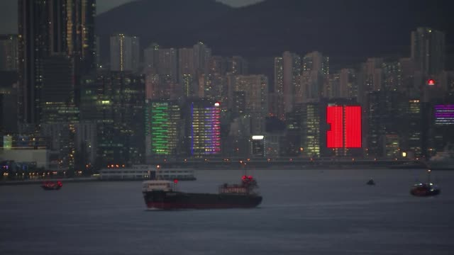protesters clash with police over proposed extradition law hong wide shot of hong kong skyline including hong kong cultural centre and skyscrapers... - bank of china tower hong kong bildbanksvideor och videomaterial från bakom kulisserna