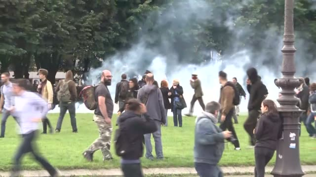protesters clash with riot police during a national demonstration and strike against the labor law reform at les invalides square in paris france on... - confrontation stock videos and b-roll footage