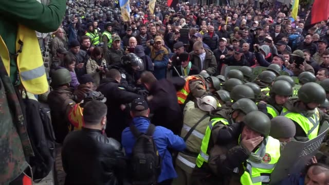 Protesters clash with riot police during a rally of Ukrainian opposition outside the parliament in Kiev Ukraine on October 17 2017 Mikheil...
