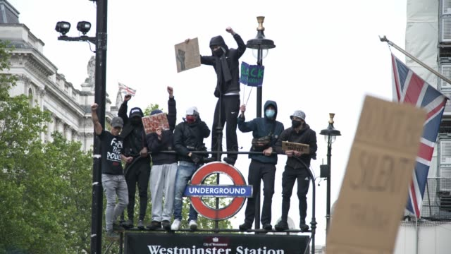 protesters climb the westminster underground sign, whitehall after the black lives matter march on june 6th, 2020 in london, england. the death of an... - anxiety stock videos & royalty-free footage