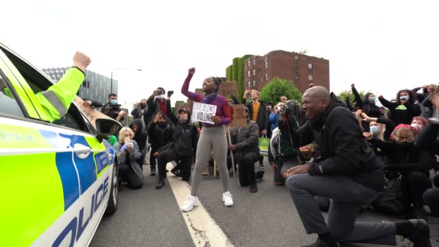 protesters demand an act of solidarity from police as they surround and block their vechcals as tensions run high outside the us embassy during a... - london england stock videos & royalty-free footage