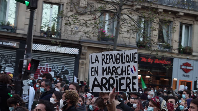 protesters demonstrate against the french government's global security law as thousands march between place de la république and place de la bastille... - law stock videos & royalty-free footage